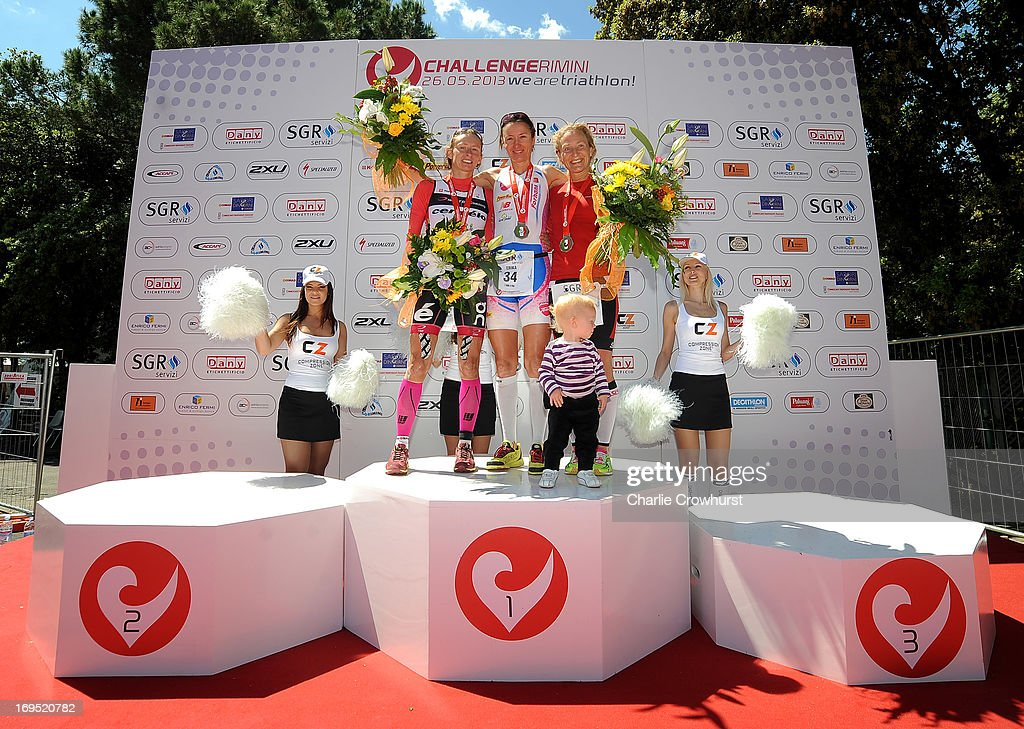 Womens winner Erika Csomor (C) stands with Diana Riesler (L) andCamilla Lindholm (R) during the Challenge Family Triathlon Rimini on May 26, 2013 in Rimini, Italy.