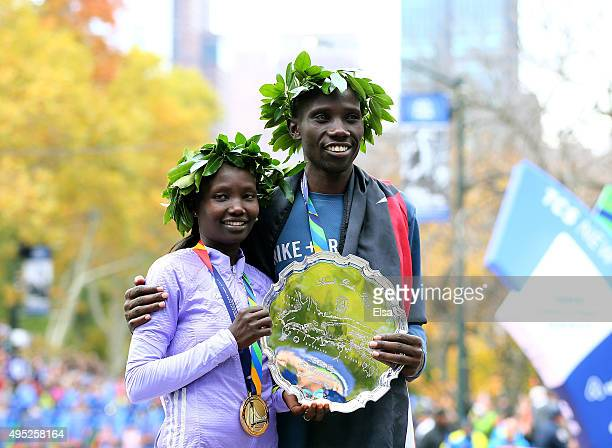 Women's winner Mary Keitany of Kenya and men's winner Stanley Biwott of Kenya pose with their medals after the TCS New York City Marathon on November...