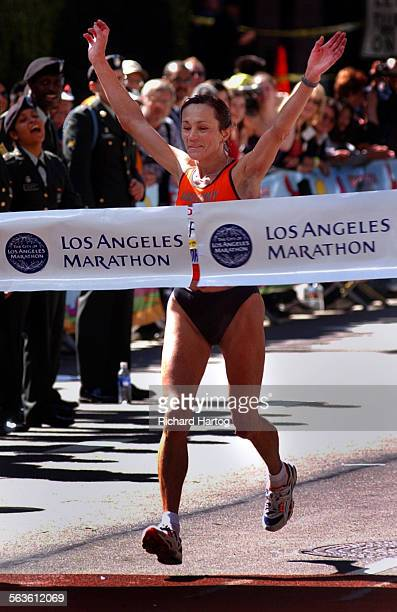 Women's winner Tatyana Pozdnyakova is all smiles as she crosses the finish line @@*for the second time@@* during the LA Marathon Sunday morning in...