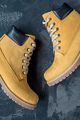 Women's winter boots. Yellow warm boots for trekking.