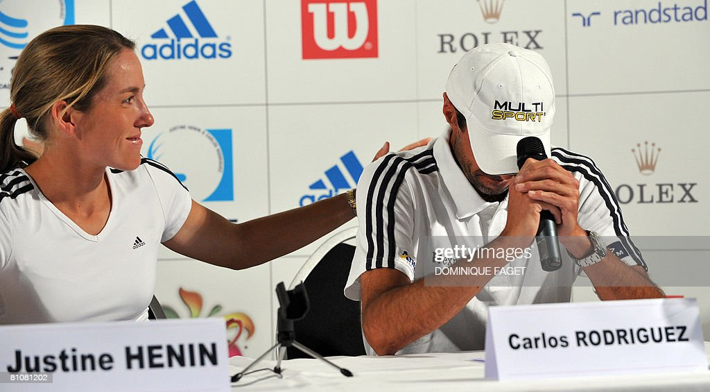 Women's world number one tennis player Justine Henin of Belgium and coach Carlos Rodriguez speak at a press conference on May 14 at the Justine N1...