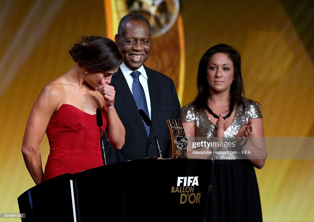 Women's World Player of the Year winner <a gi-track='captionPersonalityLinkClicked' href=/galleries/search?phrase=Carli+Lloyd&family=editorial&specificpeople=736799 ng-click='$event.stopPropagation()'>Carli Lloyd</a> of the United States and Houston Dash accepts her award with FIFA Acting President <a gi-track='captionPersonalityLinkClicked' href=/galleries/search?phrase=Issa+Hayatou&family=editorial&specificpeople=541876 ng-click='$event.stopPropagation()'>Issa Hayatou</a> and <a gi-track='captionPersonalityLinkClicked' href=/galleries/search?phrase=Nadine+Kessler&family=editorial&specificpeople=683339 ng-click='$event.stopPropagation()'>Nadine Kessler</a> of Germany during FIFA Ballon d'Or Gala 2015 at the Kongresshaus on January 11, 2016 in Zurich, Switzerland.