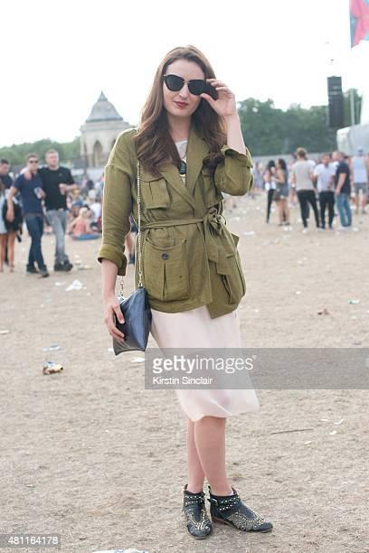 Womenswear designer Bobbie Hudson wears an H and M jacket Zara boots Whistles bag ASOS dress Miu Miu sunglasses at Lovebox 2015 on July 17 2015 in...