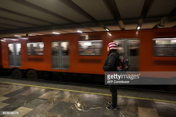 A womna waits at a subway station in Mexico City early on September 25 2017 almost a week after a magnitude 71 quake struck central Mexico Hopes of...