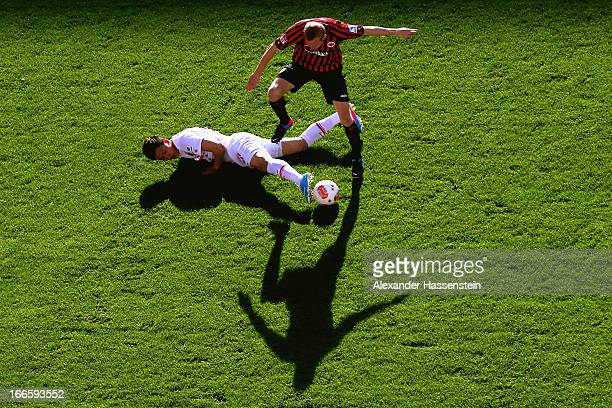 Won Dong Ji of Augsburg battles for the ball with Sebastian Rode of Frankfurt during the Bundesliga match between FC Augsburg and Eintracht Frankfurt...