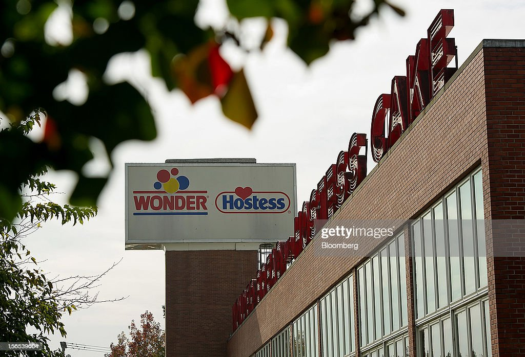 Wonder Bread and Hostess signs sit on top of the Hostess Brands Inc. building stands in Sacramento, California, U.S., on Friday, Nov. 16, 2012. Hostess, which also makes Wonder bread, Ding Dongs and Ho Hos, plans to fire more than 18,000 employees and liquidate assets after a nationwide strike by bakery workers crippled operations. Photographer: David Paul Morris/Bloomberg via Getty Images