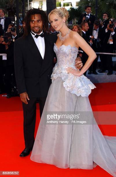Wonderbra model Adriana Karembu and her husband footballer Christian Karembeu arrive for the premiere of the documentary film 'Searching for Debra...