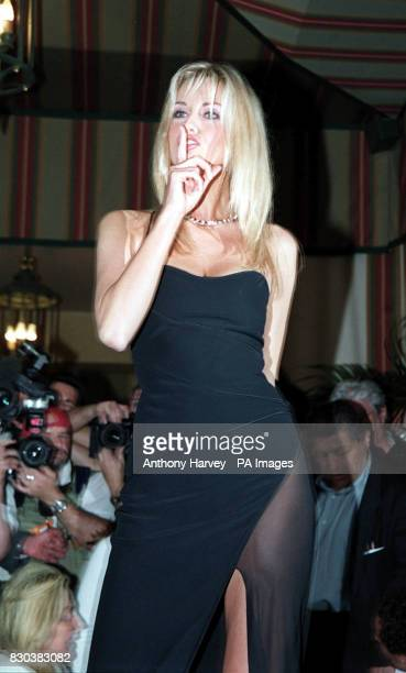 Wonderbra model Adriana Sklenarikova tries to keep photographers quiet during a photocall at the opening day of the 53rd Cannes film festival in...