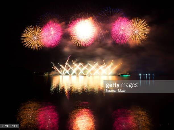 Wonderful colors of fireworks reflected in the water.