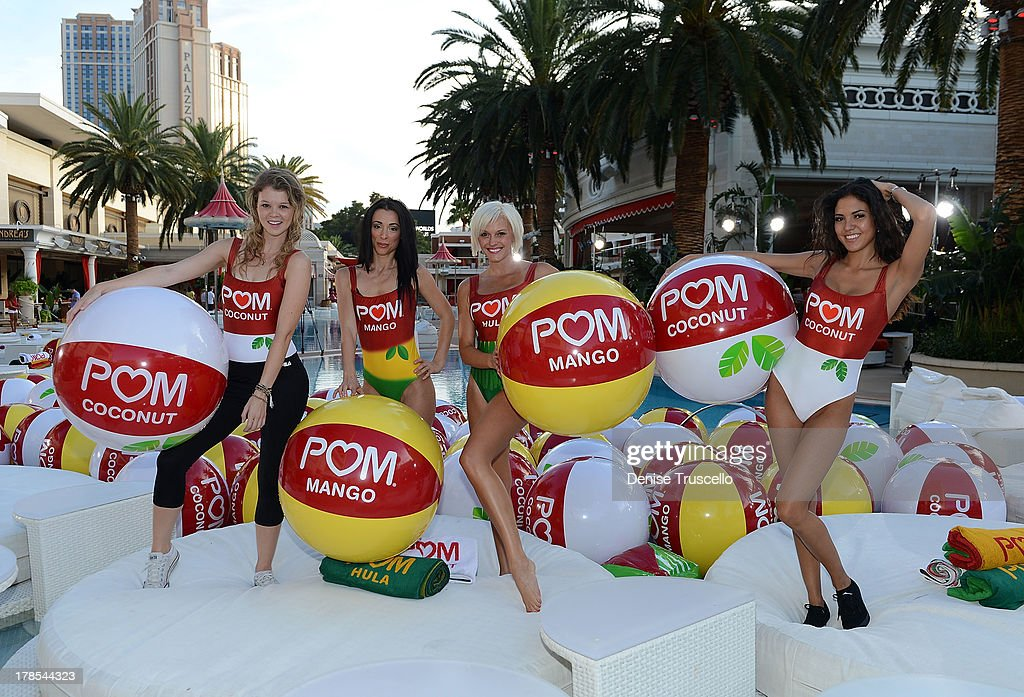 Wonderful dancers POM Hula, POM Coconut and POM Mango celebrate the launch of POM Juice Blends where 125 people set the Guinness World Record for the longest beach-ball bounce in history, which was led by Cheryl Burke and Karina Smirnoff at the Encore Beach Club at Wynn Las Vegas on August 29, 2013 in Las Vegas.