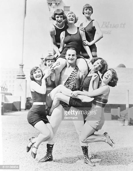 A Wonderful Handler of the Ladies Los Angeles California Photo shows Bonomo world's strongest human as he bears seven bathing girls between scenes on...