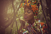 Wonderful scents of spring. African American woman in the park.
