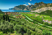 Stunning landscape with Lake Garda and Sarca river near Torbole town, Northern Italy, Europe