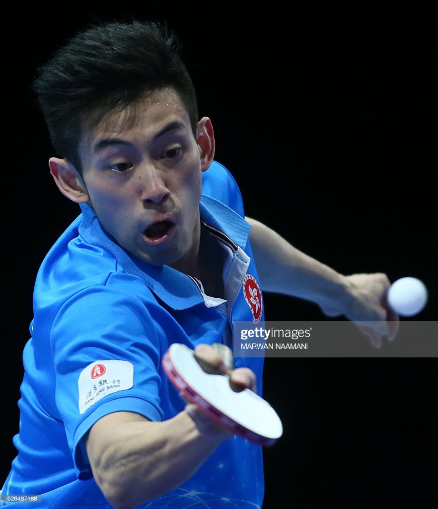 Wong Chun Ting of Hong Kong returns the ball to Gao Ning of Singapore during their men's singles third and fourth place table tennis match in the ITTF Nakheel Table Tennis Asian Cup, on April 30, 2016 in Dubai. / AFP / MARWAN