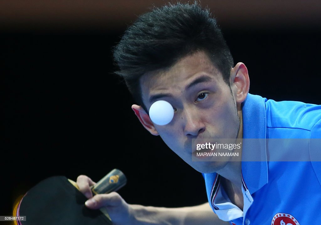 Wong Chun Ting of Hong Kong serves the ball to Gao Ning of Singapore during their men's singles third and fourth place table tennis match in the ITTF Nakheel Table Tennis Asian Cup, on April 30, 2016 in Dubai. / AFP / MARWAN