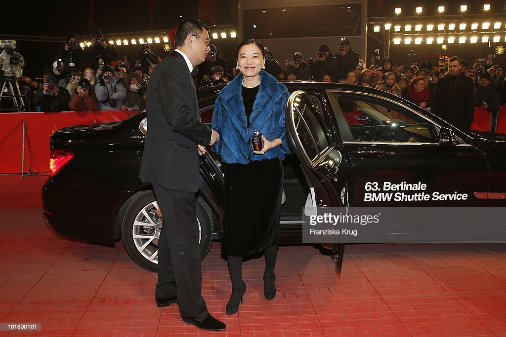 Wong Kar Wai and his wife Esther (R) attend the Closing Ceremony Red Carpet Arrivals - BMW At The 63rd Berlinale International Film Festival at Berlinale-Palast on February 16, 2013 in Berlin, Germany.