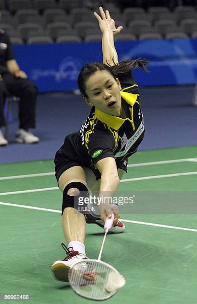 Wong Mew Choo of Malaysia returns the shuttlecock to South Korea's Hwang Hye Youn during their women's singles match in the preliminary matches of...