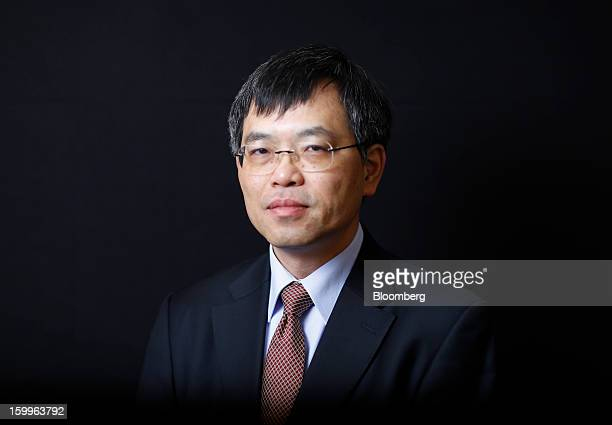 Wong Wai Ming chief financial officer of Lenovo Group Ltd poses for a photograph following a Bloomberg Television interview on day two of the World...