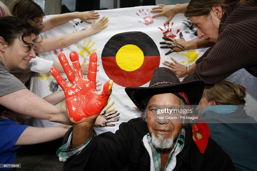 Wongkumarra Tribal elder Donny Dixon joins members of Wongkumarra Solidarity Ireland (WSI) putting handprints on a banner outside the Australian Embassy in Dublin, protesting at what they say is Australia's continued mistreatment of indigenous peoples and the Embassy's refusal to make a public statement on the matter.