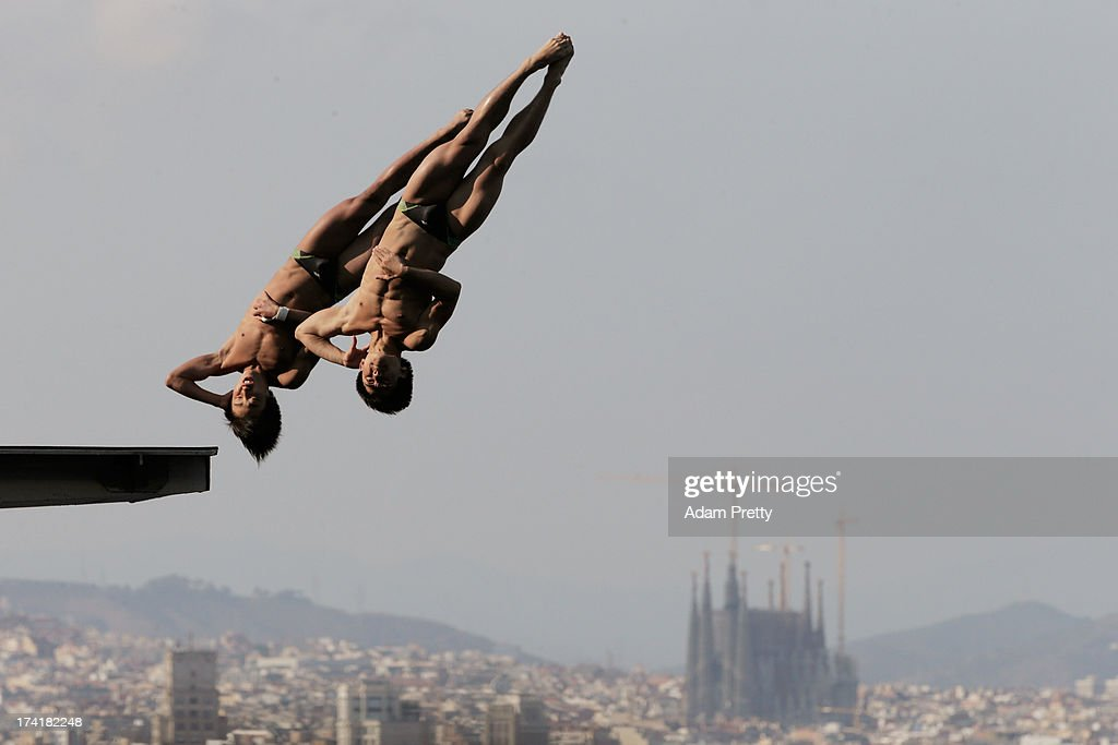 Woo Haram and Kim Yeongnam of Korea compete in the Men's 10m Platform Synchronised Diving final on day two of the 15th FINA World Championships at Piscina Municipal de Montjuic on July 21, 2013 in Barcelona, Spain.