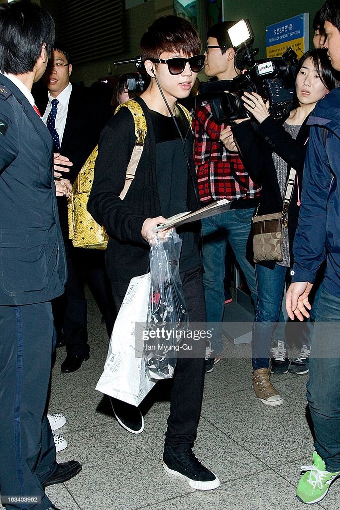 Woo Hyun of South Korean boy band Infinite is seen on departure at Incheon International Airport on March 8, 2013 in Incheon, South Korea.