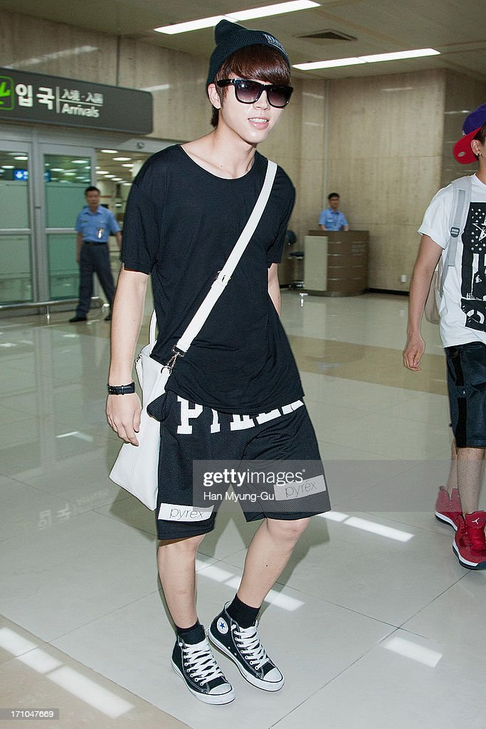 Woo Hyun of South Korean boy band Infinite is seen upon arrival at Gimpo International Airport on June 21, 2013 in Seoul, South Korea.