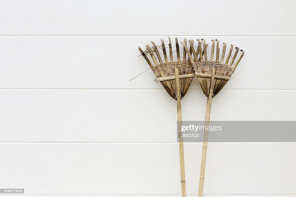 Wood, bamboo harrow on wall : Stock Photo