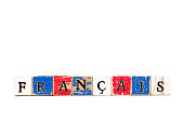 "Wood Block Letters Spelling ""Français""; White background with plenty of copy space. The wood blocks are painted the colors of the French flag: red, white and blue."