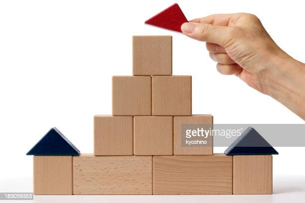 Wood blocks house made by hand on white background.