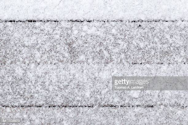 Wood boards covered in snow, viewed from above