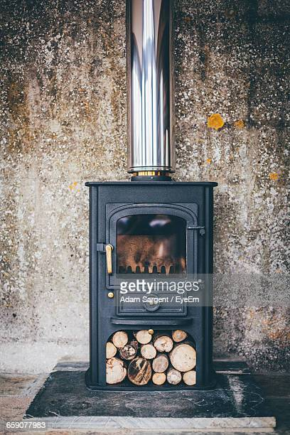 Wood Burning Stove Against Wall At Home