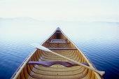 Wood canoe in morning mist