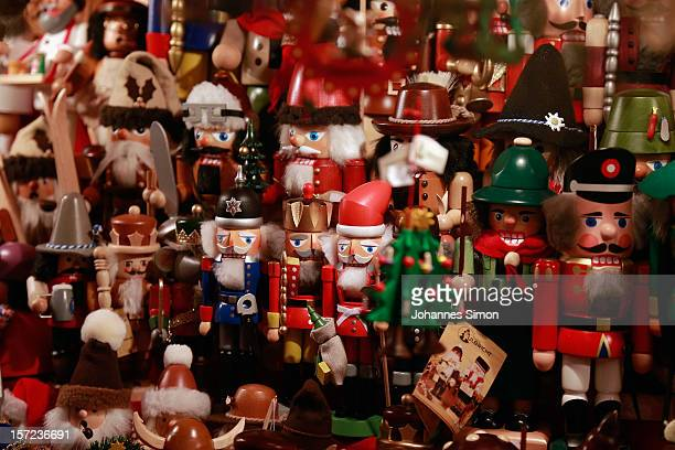 Wood carved nutcracker are displayed for sale at the traditional Christmas market 'Nuernberger Christkindlesmarkt' ahead of the opening ceremony on...