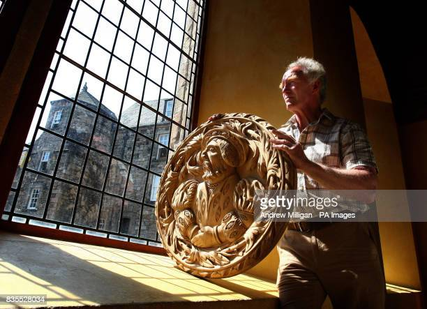 Wood carver John Donaldson with King James V one of 41 handcarved replicas of the Stirling Heads the worldfamous masterpieces of Scottish Renaissance...