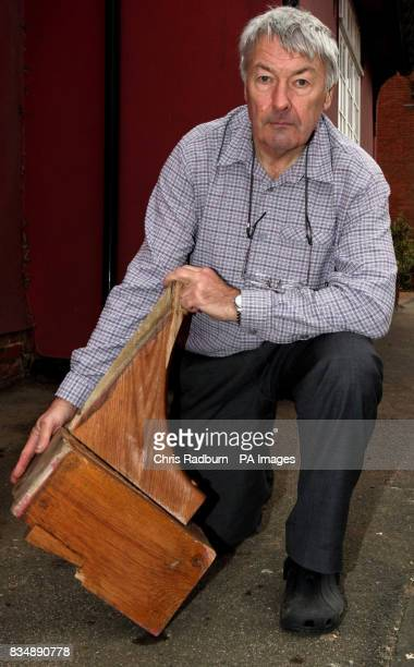 Wood carver Wynn Evans outside his 500yearold Tudor home in Cavendish Suffolk after a lorry knocked an oak roof beam off the side of it on Tuesday