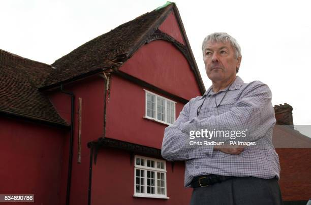 Wood carver Wynn Evans stands outside his 500yearold Tudor home in Cavendish Suffolk after a lorry knocked an oak roof beam off the side of it on...