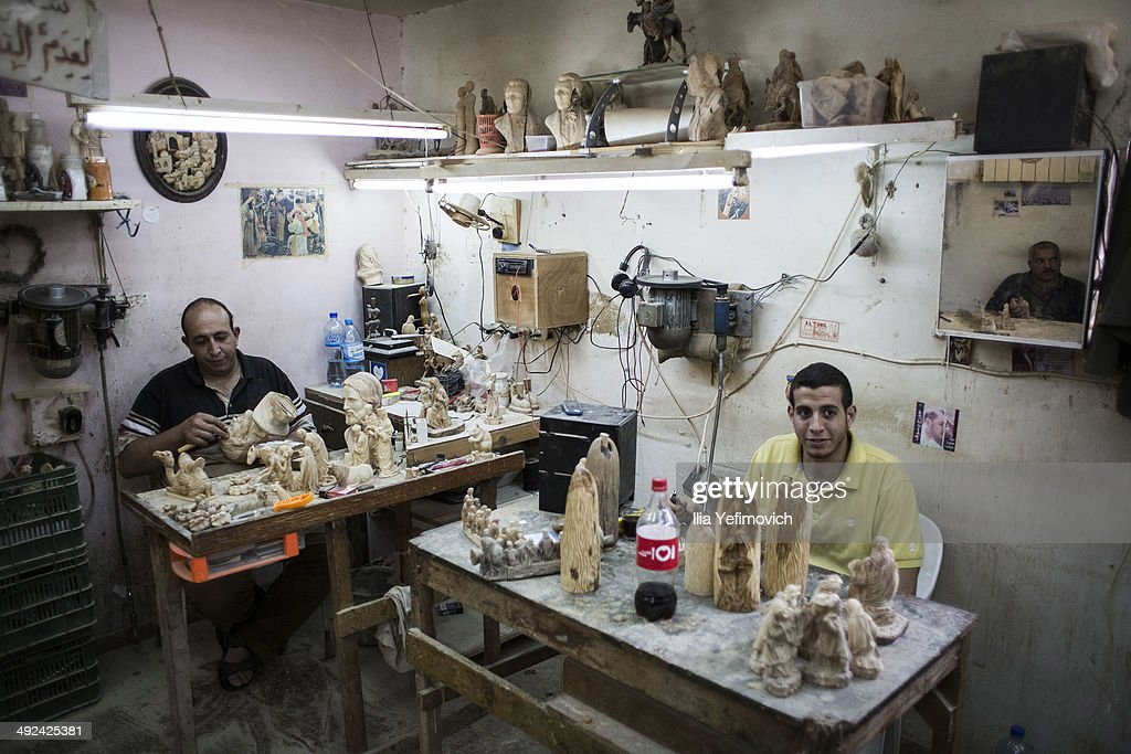 Wood carving factory workers create Biblical wooden sculptures to be sold to tourists on May 20, 2014 in Bethlehem, West Bank. Pope Francis is due to make his first visit to the Holy Land as pontiff and will visit both the West Bank and Israel this coming Sunday. The Pope will celebrate two public Masses during his visit, one in Amman, Jordan and the other in Manger Square in Bethlehem.