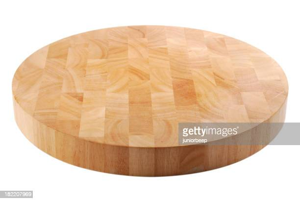 A wood chopping board in a circle shape divided to squares