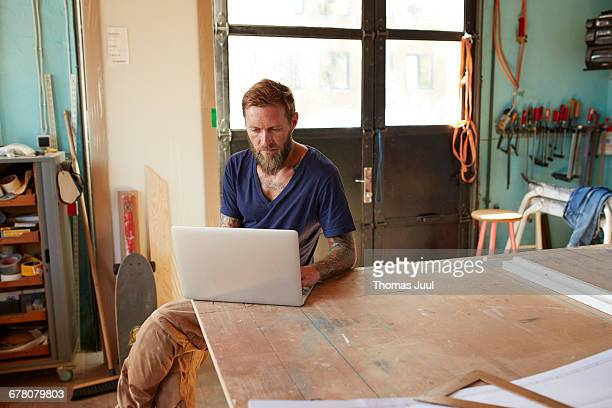 Wood Designer working with laptop