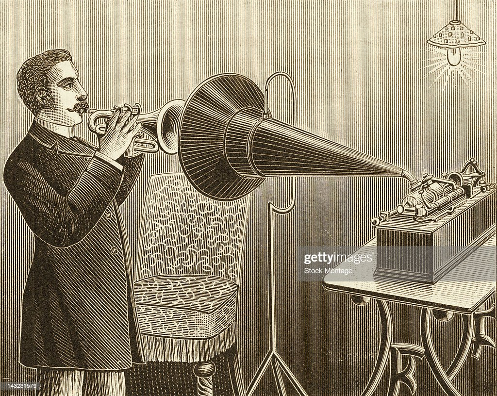 A wood engraving depicts a cornet player as his performance is recorded onto a cylinder via the large horn of a phonograph machine circa 1889