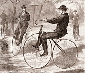 Wood engraving from Harper's Weekly magazine entitled 'American Velocipede' depicts several welldressed men as they bicycle in a park 1868