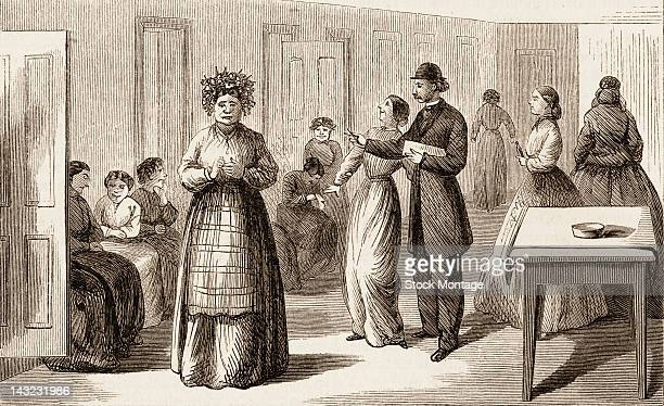 Wood engraving shows a doctor as he makes morning rounds at the New York City Lunatic Asylum Hospital Blackwell's Island New York New York circa 1865...