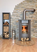 burning wood fired stove in living room