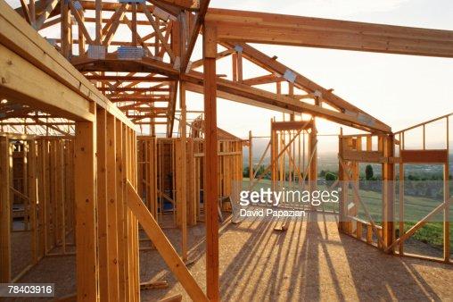 wood frame house under construction stock photo