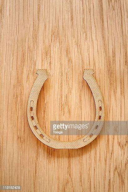 Wood horseshoe on wood