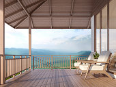 Wood house terrace with mountain 3d render, There are wood floor.Furnished with fabric and wooden furniture. There are wooden railing overlooking the surrounding nature and mountain