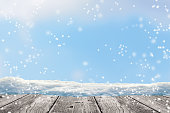 grey wooden floor in front of a snow winter background