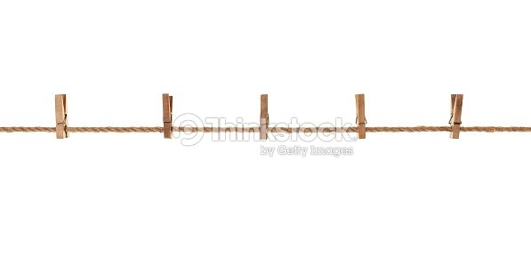 Wood Old Clothes Pegs Hanging On A Rope Stock Photo