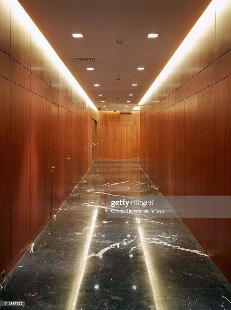 Wood paneled hallway with marble floor : Stock Photo