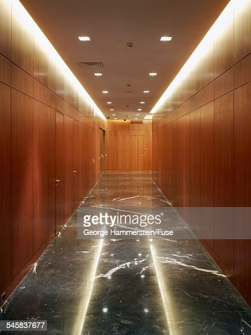 Wood paneled hallway with marble floor : Stock-Foto